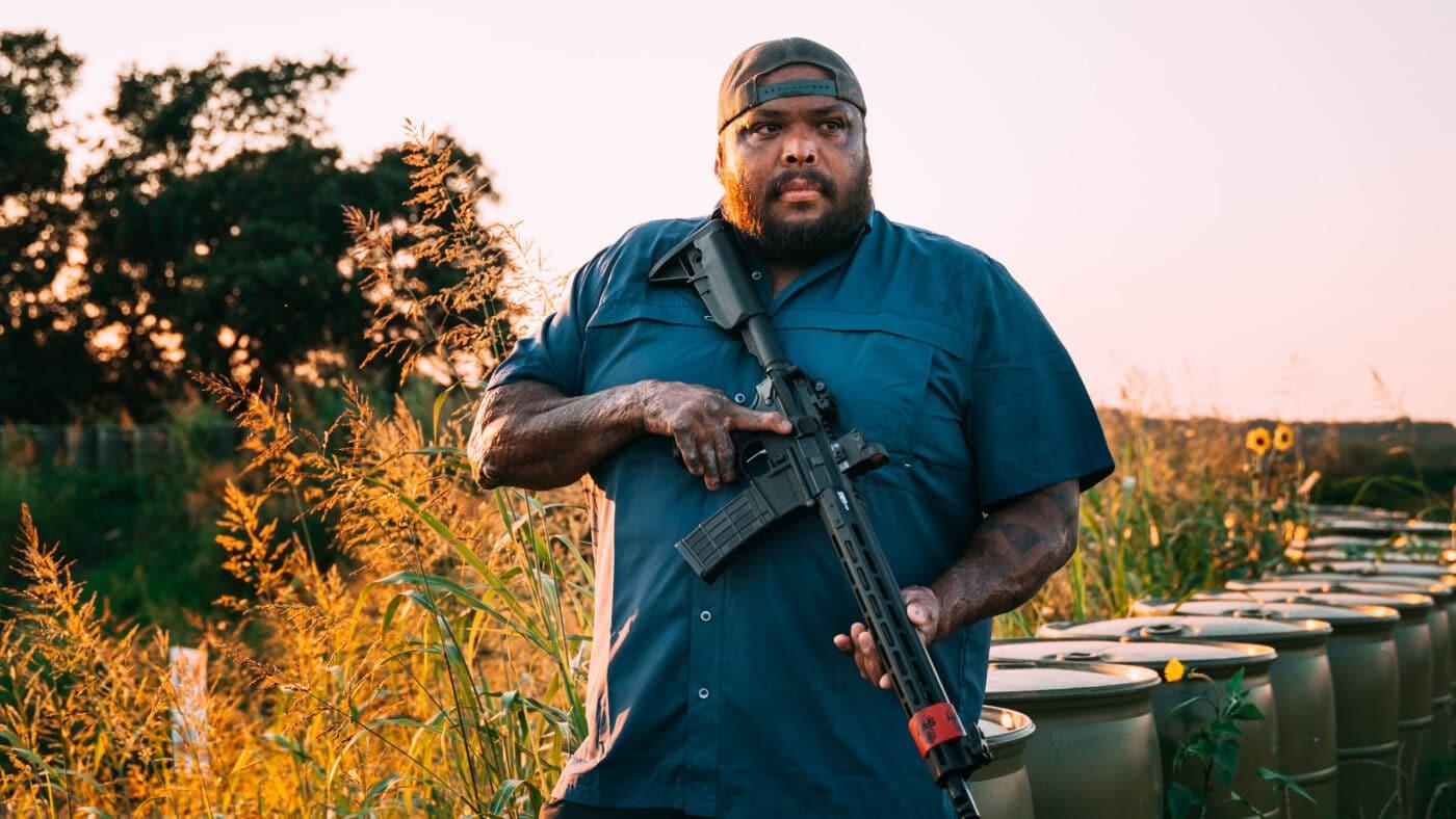"""Omar """"Crispy"""" Avila holding SAINT rifle"""