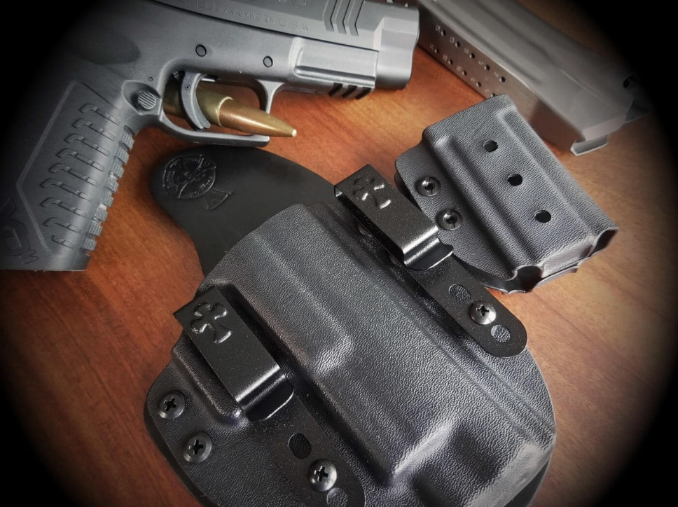 Crossbreed Reckoning IWB holster with Springfield Armory pistol next to it