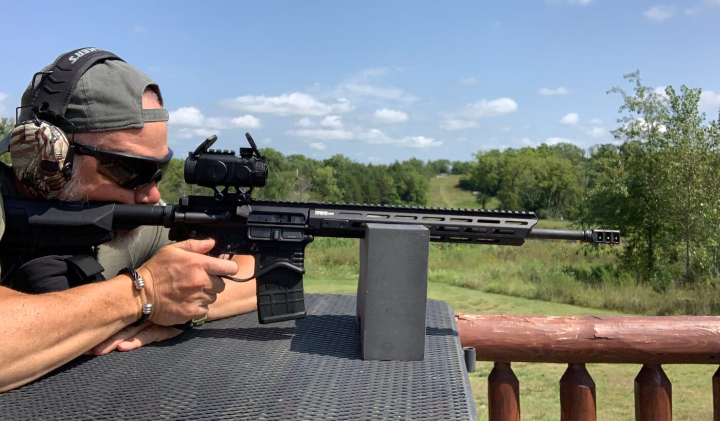 Man testing the AT3 Tactical 3X Prism Scope on the range