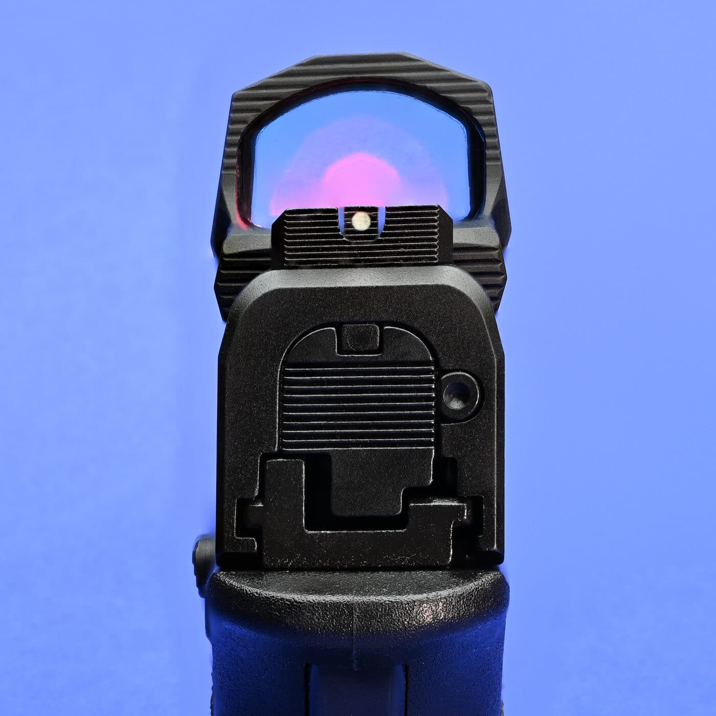HEX Wasp red dot sight co-witnessed with iron sights