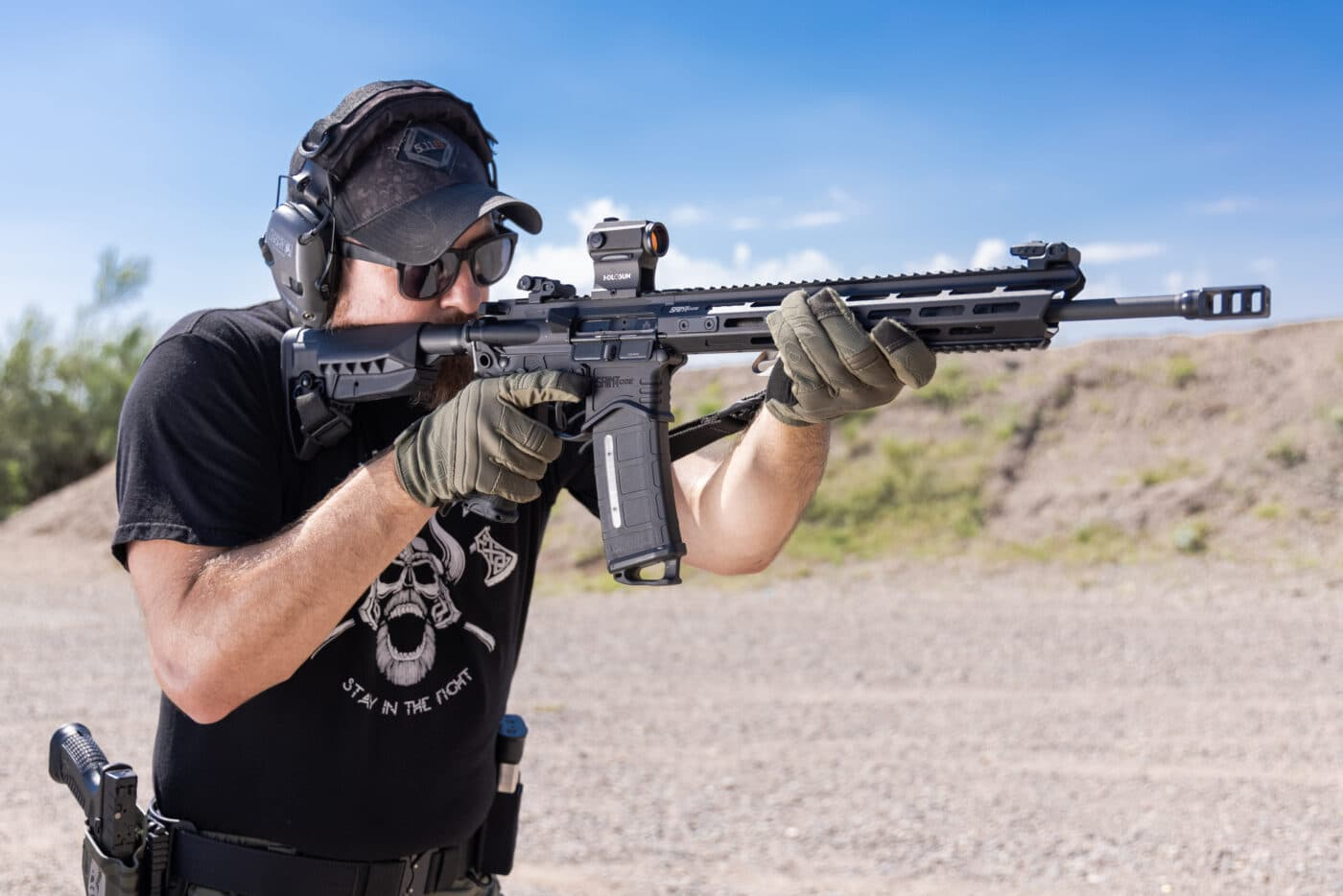 Man testing different color reticles at the range with SAINT rifle