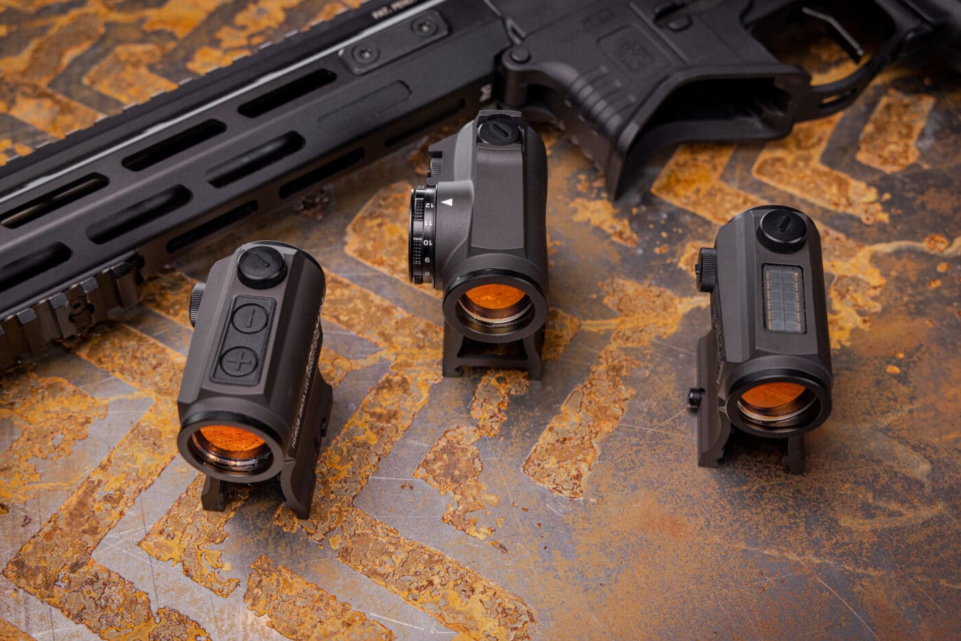Different Holosun reflex sights with varying reticle colors