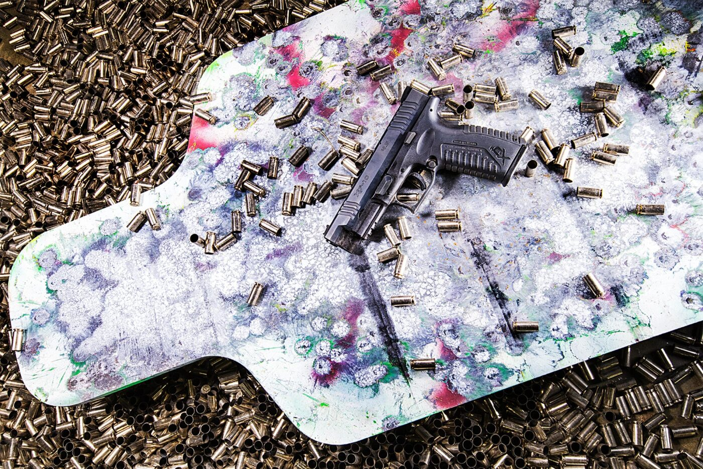 Springfield Armory XD-M 10mm pistol sitting on a target