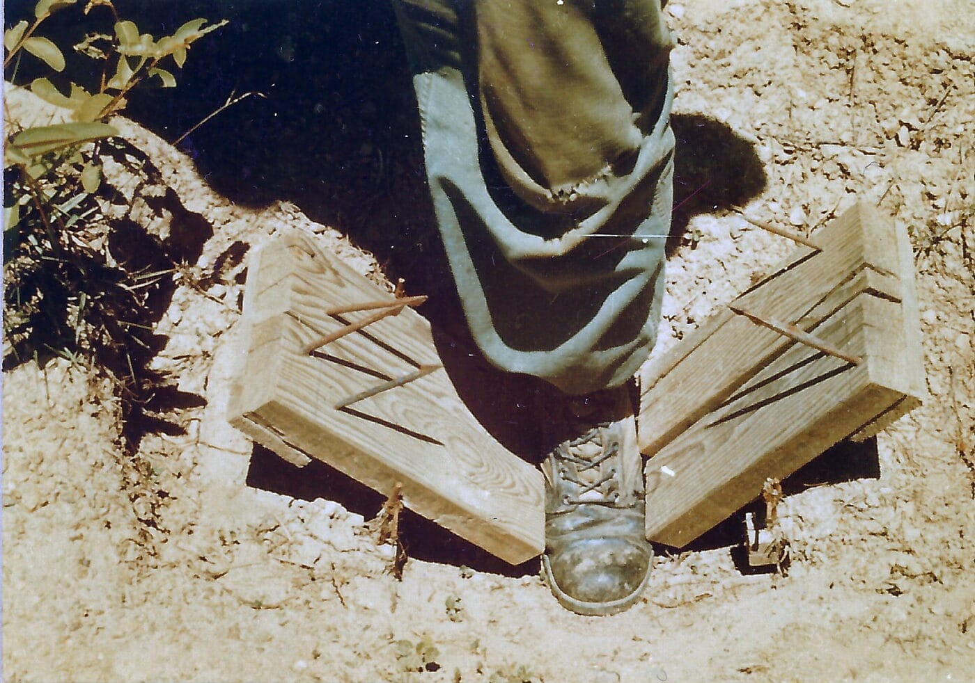A Viet Cong foot trap demonstrated by a US Marine