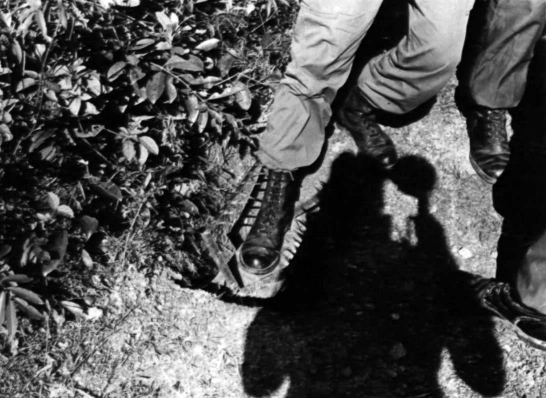 Man demonstrating a foot trap in Vietnam