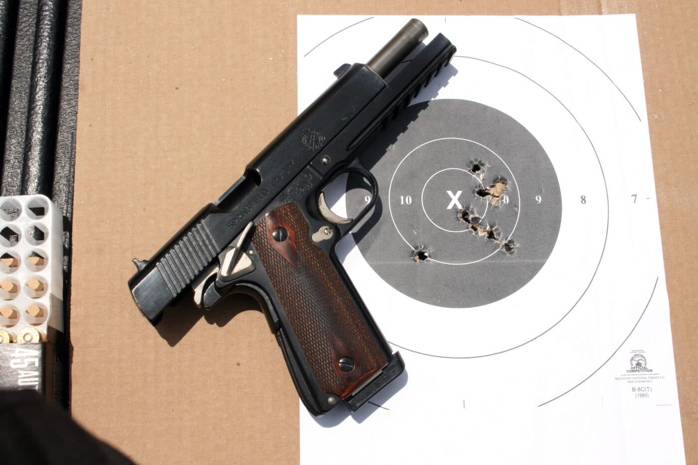 1911 pistol with target after training on the range