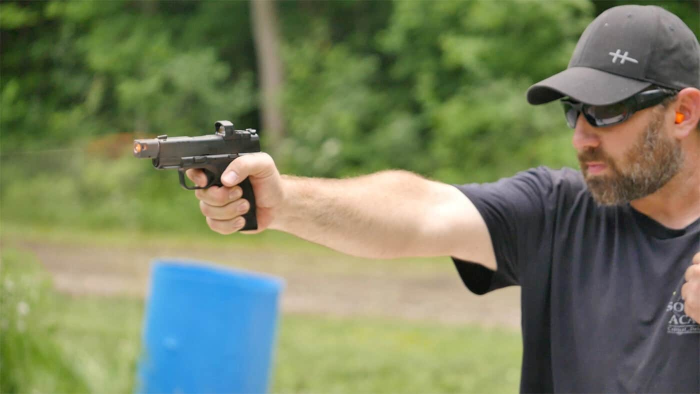 Man showing different shooting styles with the red dot sight