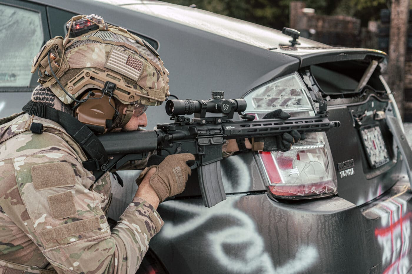 Soldier using a 1-8x scope as a red dot sight