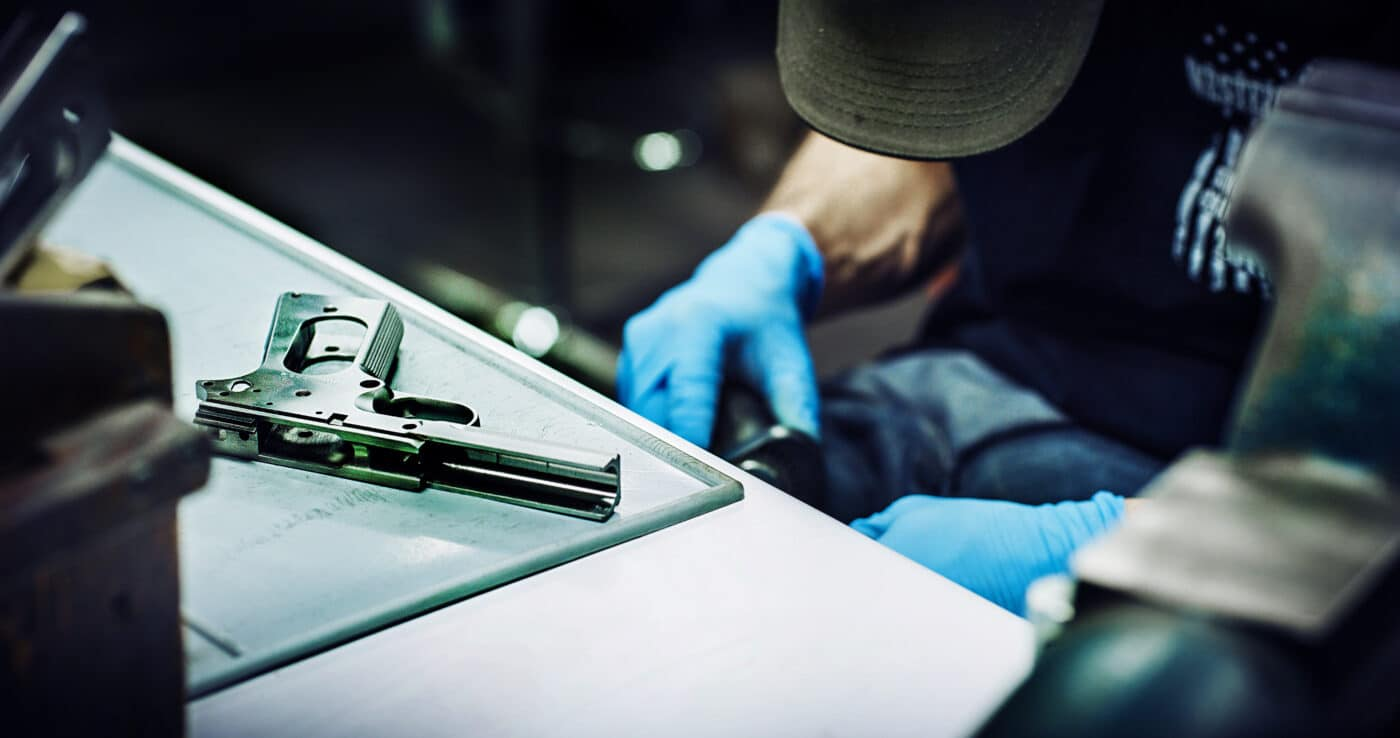 Springfield Armory armorer working on a 1911 frame