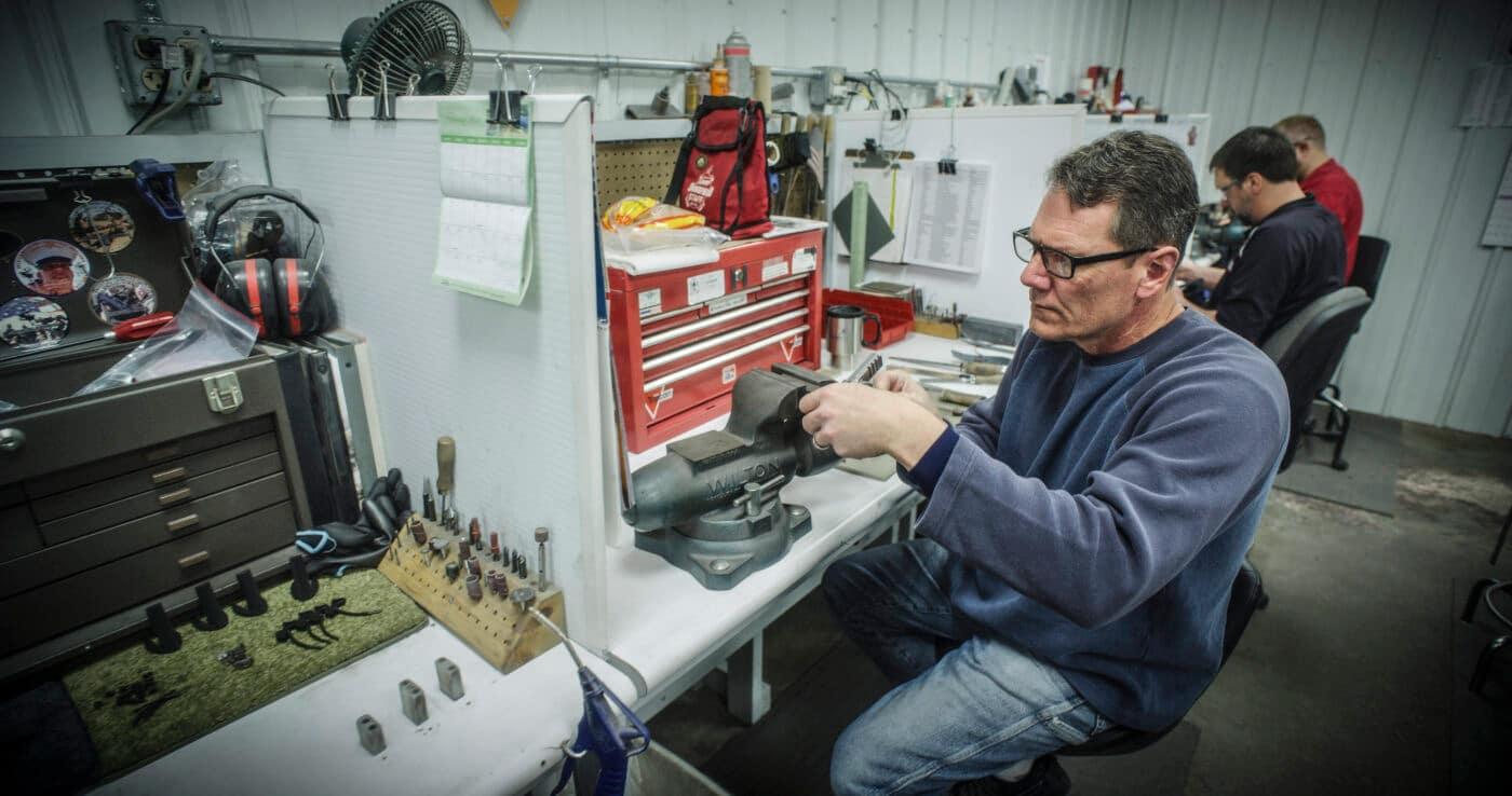 Springfield custom shop armorer working on a pistol