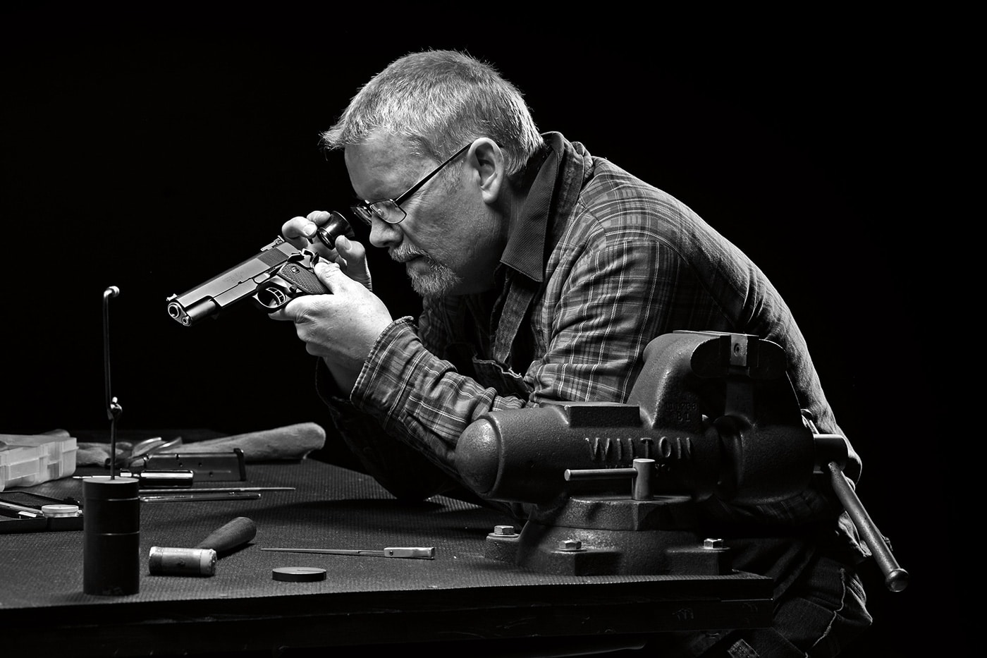 Springfield employee fixing a gun